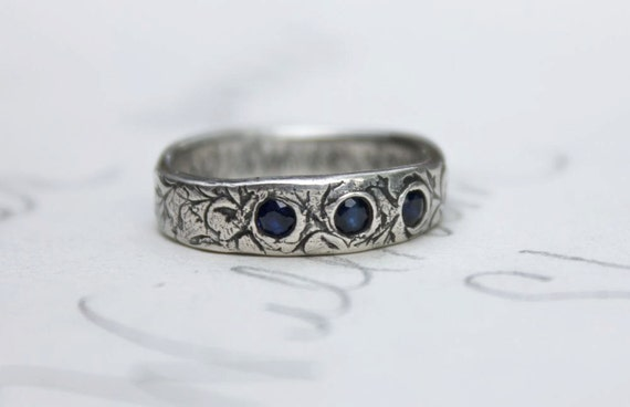 recycled silver sapphire wedding band ring . vine leaf three stone anniversary band engraved message . faceted blue fair trade sapphire ring