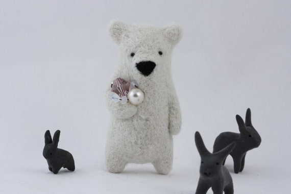 A white bear holding crystals brooch