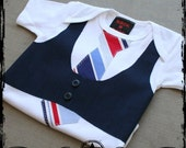 6-12M -- Navy Vest with Red, Blue and Navy Striped tie  -  White short sleeve bodysuit
