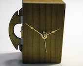 Wood purse clock. . .or is that a European carryall. . .