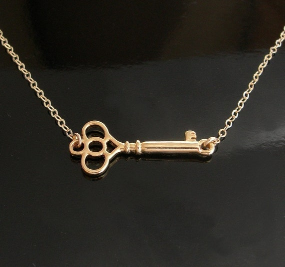 gold key necklace set sideways in 18kt gold by luluka on etsy