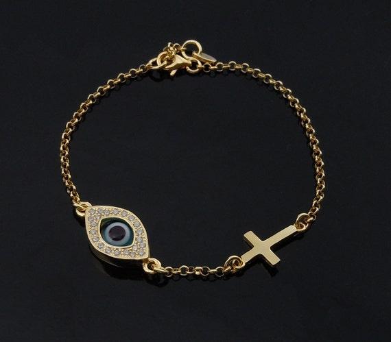 Celebrity Evil Eye and Cross Bracelet in Gold as Seen On Celebrities