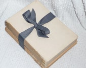 Book Bundle Wrapped in Gunmetal Gray Ribbon