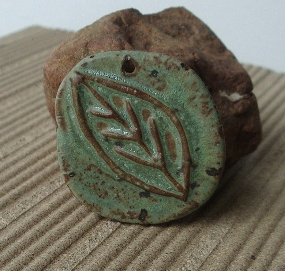Carved Sage Leaf ceramic pendant with rustic edging. Handmade with stoneware clay