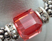 ON SALE .. Easy On beaded ring .. Sterling Silver Swarovski Crystal stretch ring with orange pink crystal cube