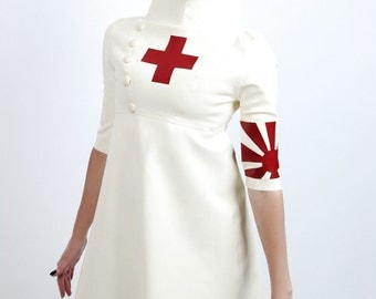 Latex/Rubber nurse dress with arm band detail