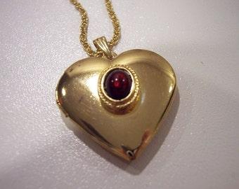 Wonderful goldtone locket with amber stone