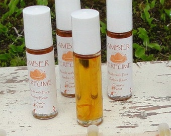 Pure AMBER roll-on Perfume with All Natural Amber Resin natural earthy sweet scent.  Comes in .35 glass bottle with easy to apply roll on