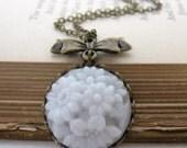 Vintage Flower Necklace White Glass Antiqued Brass Bow Filigree Pendant Charm