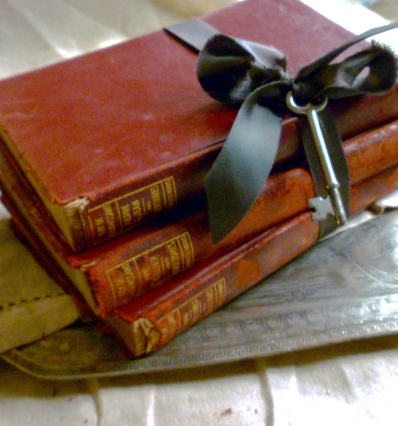 c1917 crumbly old books, black vintage ribbon and an antique key