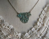 Art Nouveau, vintage style stamping pendant with rustic antiqued patina on petite chain necklace