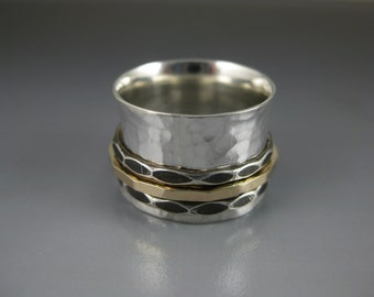 silver spinner ring with two silver and one 14k gold-filled spinner