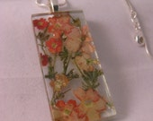 Summer apricot,tangerine,peach, colored flowers behind glass. Real flowers. Rectangle 1x2 inch pendant/necklace. Great  Gift Idea.