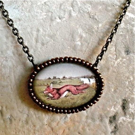 Handmade necklace of a fox and a beaded bezel. I'm a Little Fox.