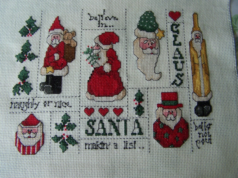 Completed cross stitch sampler santa hand
