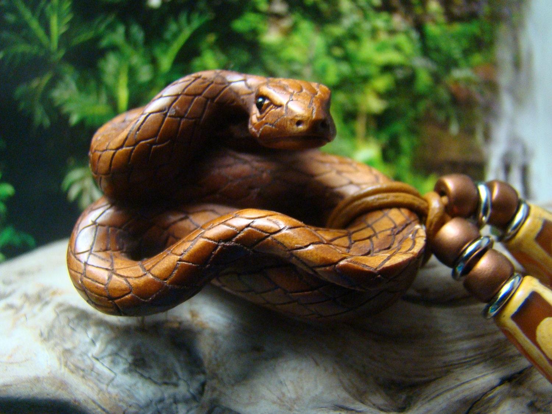 Incredible snake onyx gemstone eyes carved