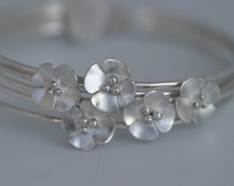 Silver Buttercup skinny stacking bangles