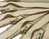 Zippers Wholesale 100 7 inch YKK Natural closed bottom coil zippers color 572 beige OVERSTOCK SALE