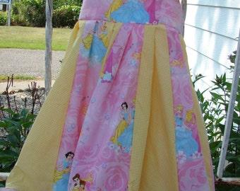 custom boutique twirl dress made with disney princess fabric 2-6
