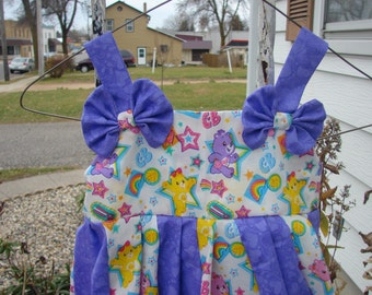 custom boutique twirl dress made with carebear fabric 2-6