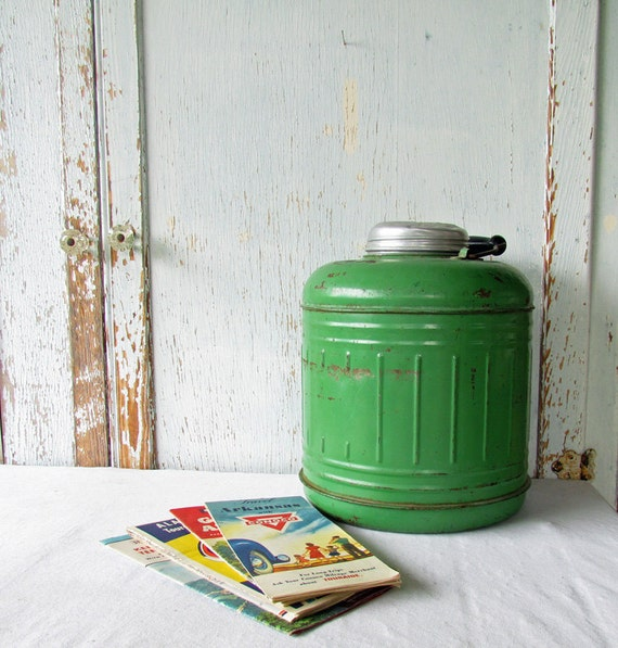 Q I purchased this water cooler about 5 years ago at a yard sale.I have checked the Web and I have not been able to find any information on the cooler. The stand is made of metal. The cooler and cover, the tray the cooler sits on and the bowl on the bottom are all made of pottery.
