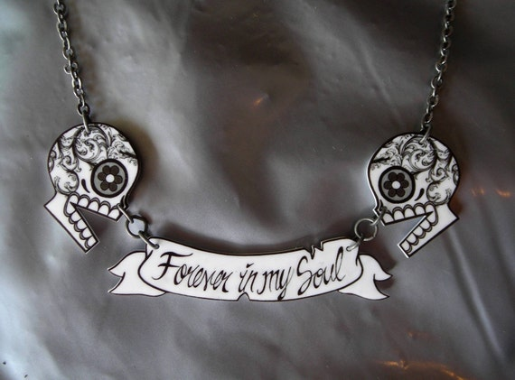 Black and White filigree Sugar Skulls with banner necklace