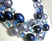 Vintage blue beaded multi strand necklace with glass and plastic beads, Lucite