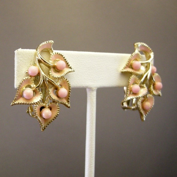 Vintage gold tone clip on earrings with light pink enamel leaves