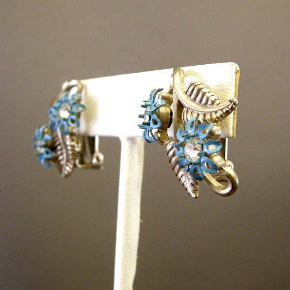 Vintage silver leaf clip on earrings with blue metal flowers, rhinestones