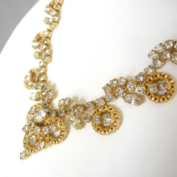 Detailed vintage gold and rhinestone bib necklace