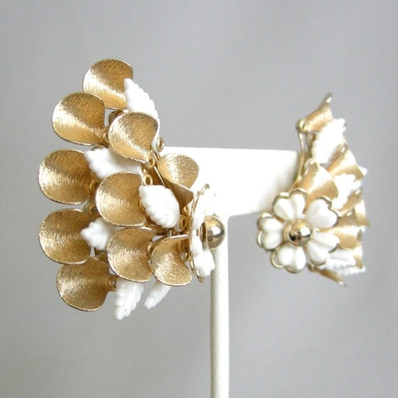 Large vintage gold metal and white plastic flower earrings, clip on