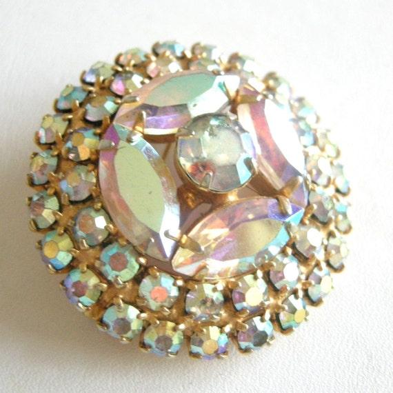 Vintage gold tone brooch with Aurora Borealis rhinestones