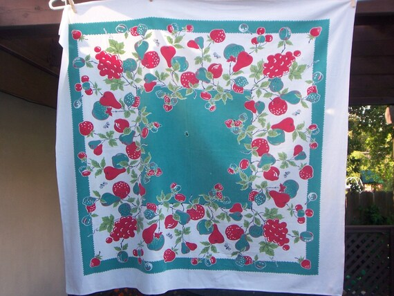 Vintage tablecloth 44x42 in aqua and red charming fruit filled with some problems