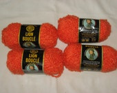Lion Brand, Lion Boucle yarn in the color tangerine