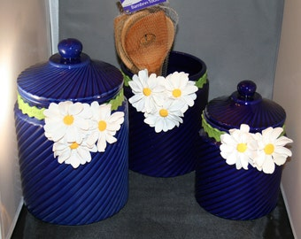 polymer clay daisies on cobalt blue cannisters