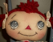 Sweet wide eyed Aubrey a 18 inch handmade Raggedy Ann doll holding a vintage 3 inch plastic squeaky elephant toy