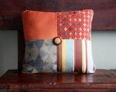 Tasmine the Traveler - Orange, Blue, Brown Pillow