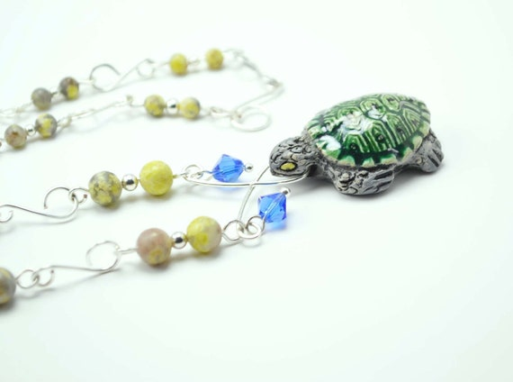 Turtle necklace made with Peruvian clay, lepidolite, and Swarovski crystal