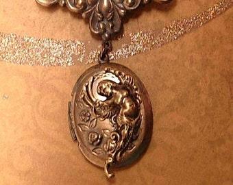 Vintage Art Nouveau winged Nude Cherub Locket brooch with old photo
