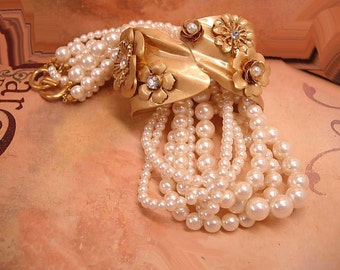 Reserved for susan FLirty 6 stand pearl necklace and Flower clamper bracelet