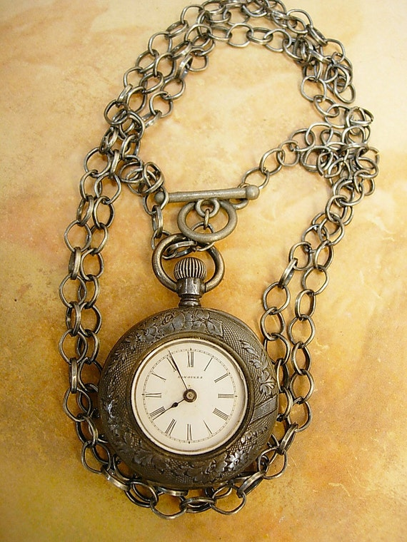 ANtique sterling artist pocketwatch necklace.. it works too.. Victorian scroll  work
