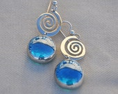 Iridescent blue drop spiral earring