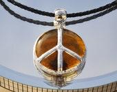 Amber glass peace pendant