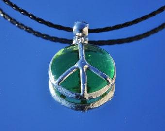 Translucent green glass bead peace pendant