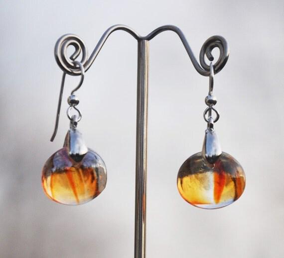 Swirls of red and orange glass drop earrings