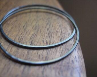 dark silver hoop earrings. seamless niobium hoops. hypoallergenic wire