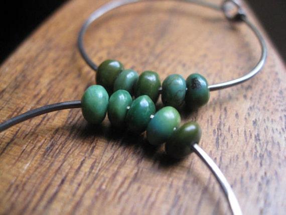 turquoise hoop earrings in grey niobium. niobium earrings. modern hoop earrings. splurge
