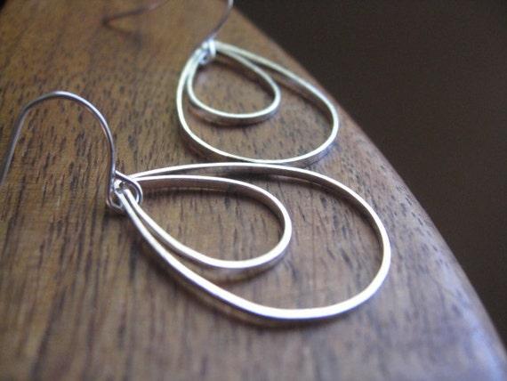 silver tear drop earrings. modern dangle earrings. splurge.