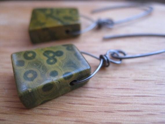 niobium earrings in olive green ocean jasper. polka dot earrings. wire wrapped briolette earrings. splurge.