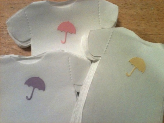 "Any quantity baby shower ""shirt"" or ""bib"" shaped paper napkins or banner decoration adorned with umbrellas - in any color."